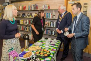 Cabinet Secretary enjoying a coffee in Wrexham Library with the Mayor and library staff