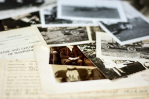 Collection of old photographs and documents on a table
