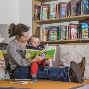 Mother and child reading stories at Children's Library Awen Libraries