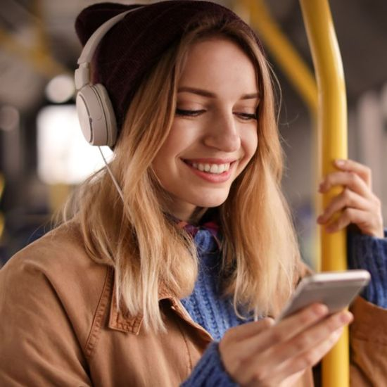 Young woman listening to Audiobooks