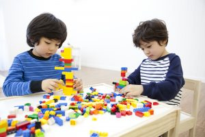 Two boys playing lego
