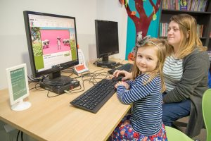 Mother and daughter using the IT Facilities at Awen Libraries