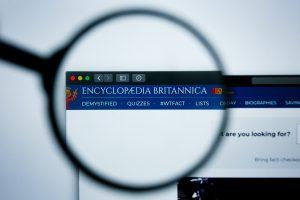 Encyclopaedia Britannica Website Header through a magnifying glass