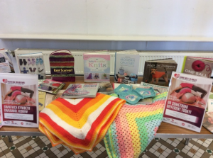 Books and knitted items in a display to promote Do Something Different Day