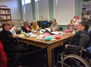 Group of people in a knitting class