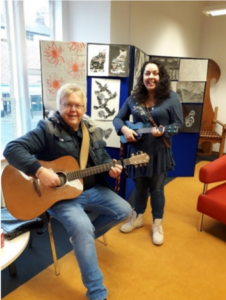 Music workshop led by Welsh artist Arfon Wyn who is playing the guitar