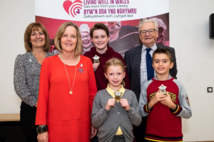 Sue Phelps MBE with Councillor Elsmore, Lilly, Ava, Lord Dafydd Elis Thomas and James after the prize ceremony