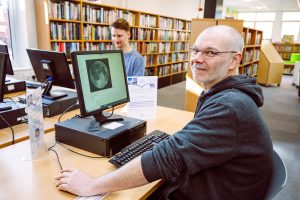 Library user using the IT Facilities at Awen Libraries