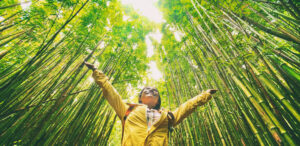 Girl with Open Arms surrounded by Bamboo