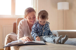 Adult and child reading a story together